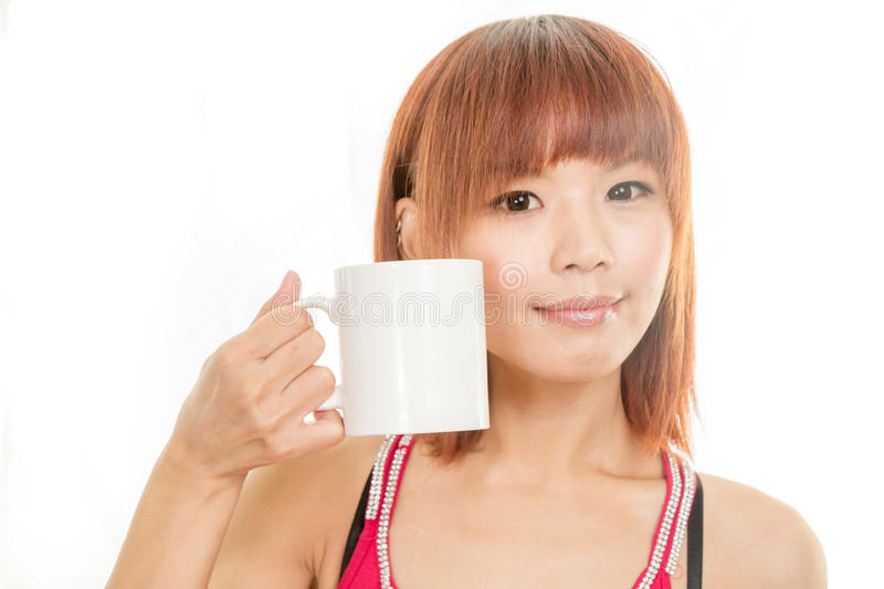 Asian woman drinking from white coffee cup royalty free stock photo