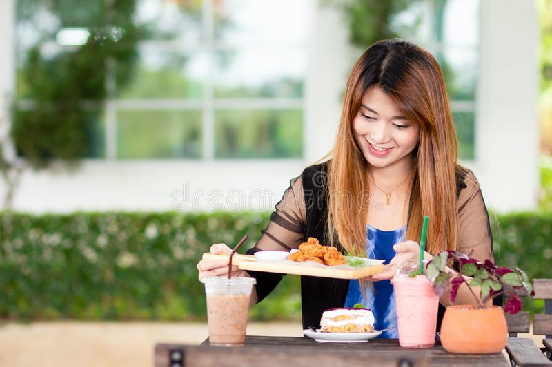 Asian woman with desserts royalty free stock image