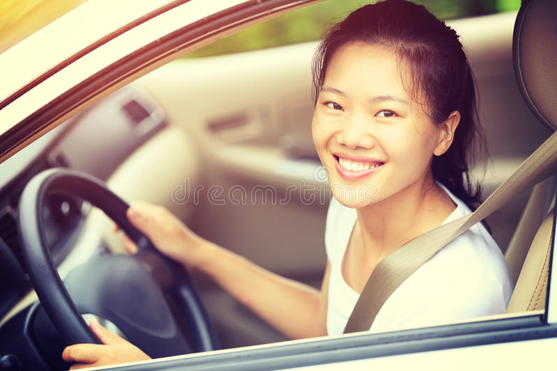 Asian woman driver driving a car royalty free stock images
