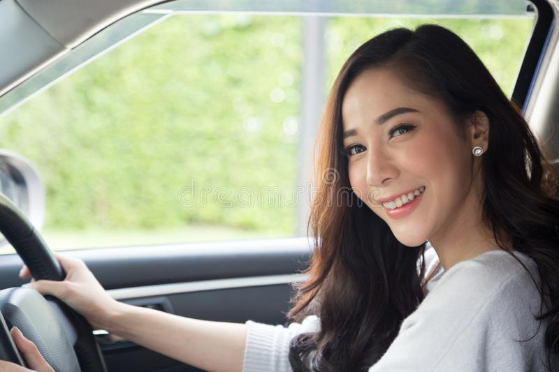 Asian women driving a car and smile happily stock photo