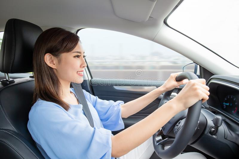 Asian woman driving car royalty free stock photos