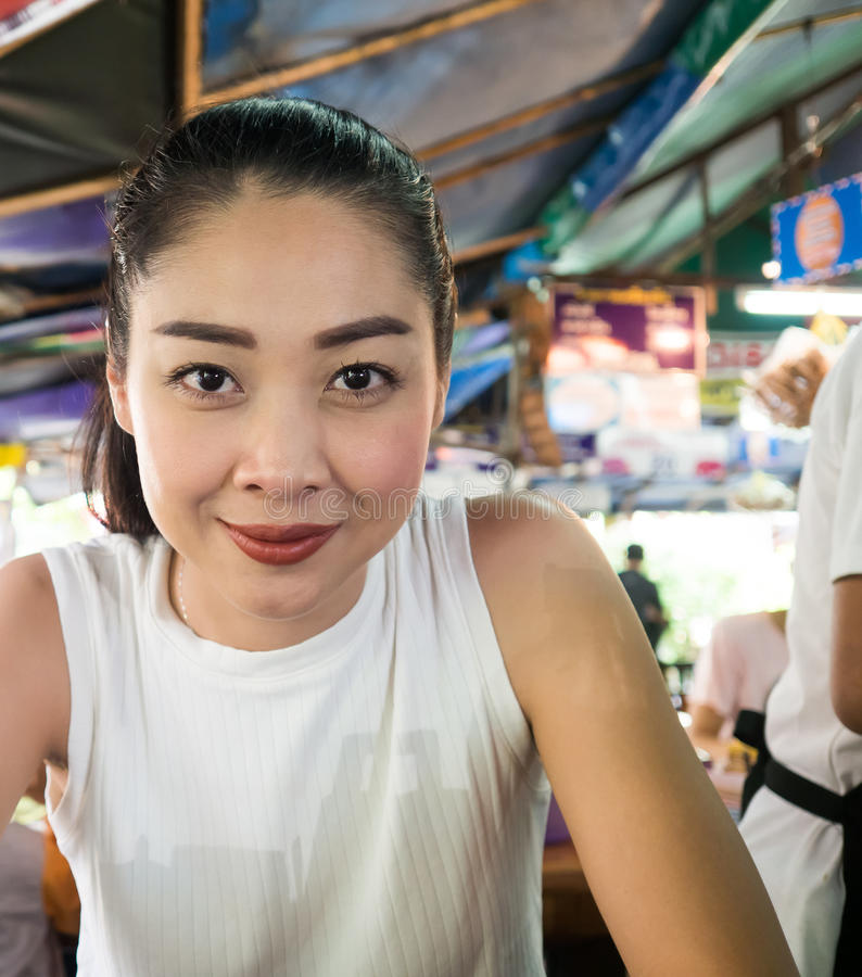 Asian woman eating noodle in Thai local restaurant. Asian woman eating noodle in Thai local restaurant in Thailand stock images