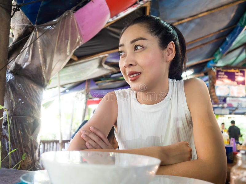 Asian woman eating noodle in Thai local restaurant. Asian woman eating noodle in Thai local restaurant in Thailand royalty free stock images
