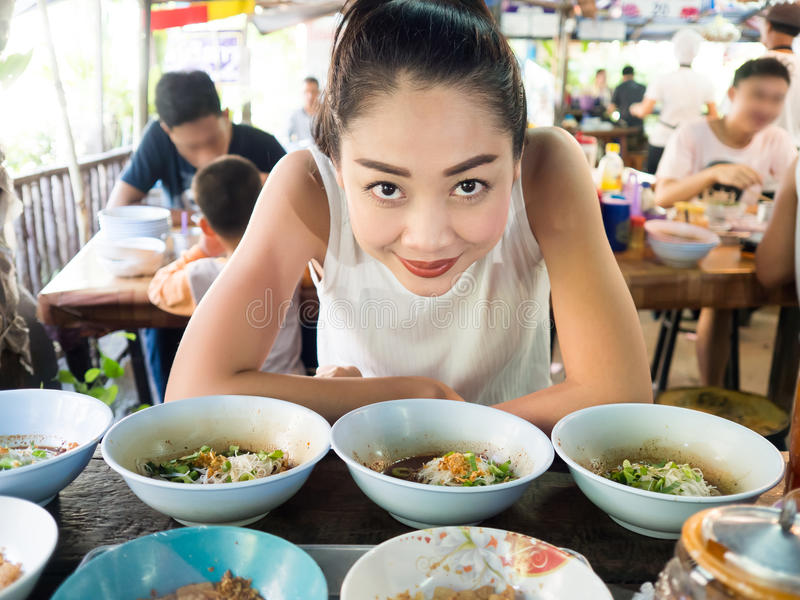 Asian woman eating noodle in Thai local restaurant. Asian woman eating noodle in Thai local restaurant in Thailand royalty free stock photo