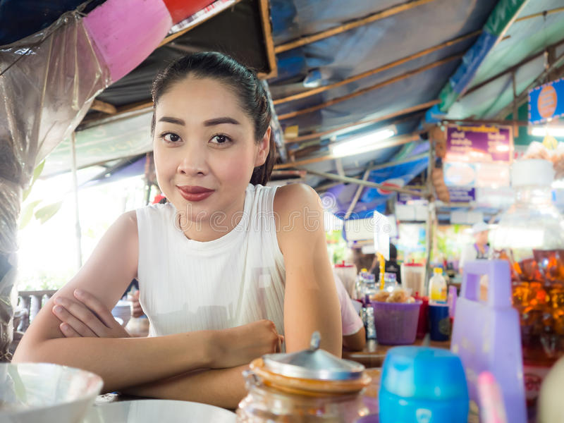Asian woman eating noodle in Thai local restaurant. Asian woman eating noodle in Thai local restaurant in Thailand stock photo