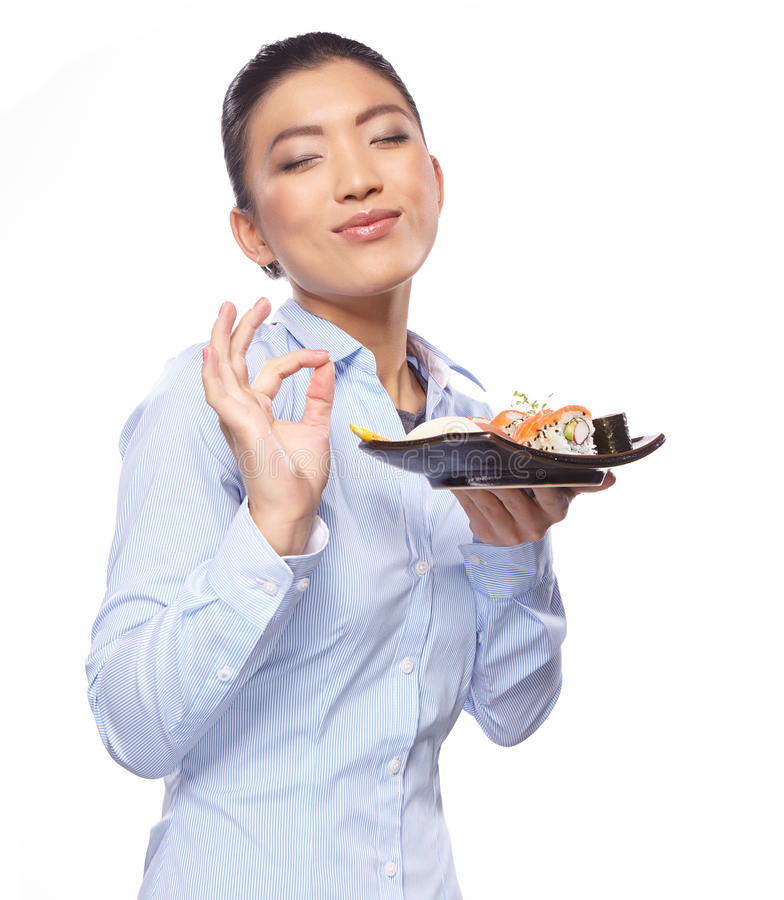 Asian woman eating sushi. Shallow depth of field, focu royalty free stock photos