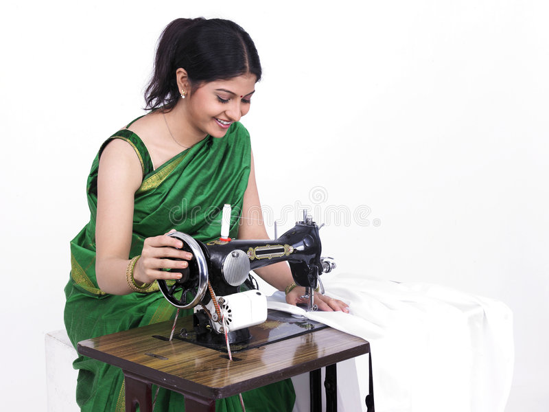 Asian woman engaged in sewing