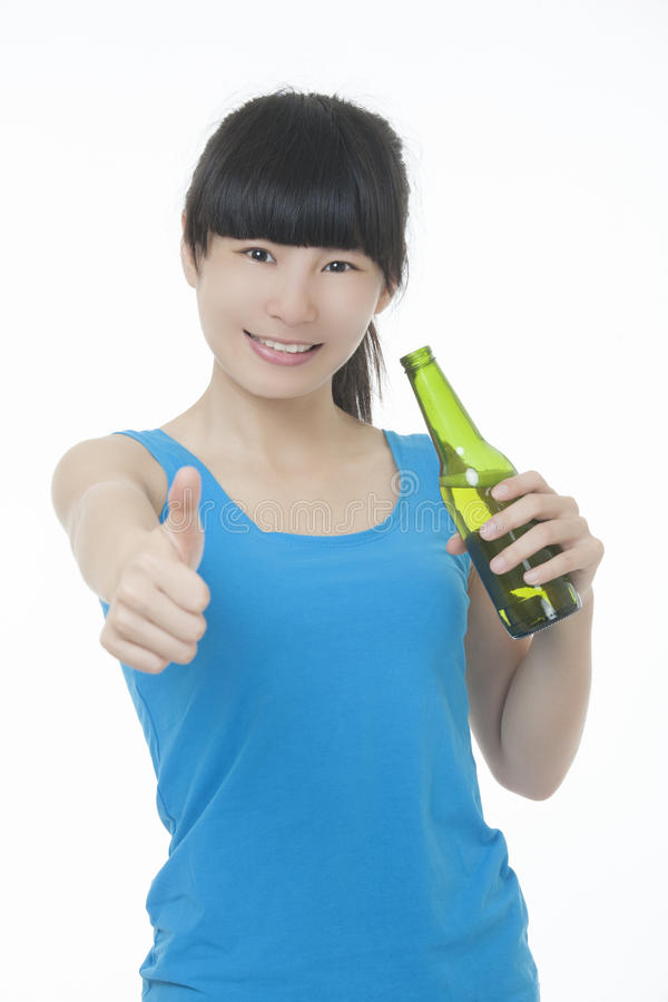 Asian woman enjoying a bottle of beer isolated on white background stock photo