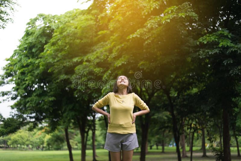 Asian women enjoying and freedom with open hands,Female rise hand up enjoy nature outdoor royalty free stock images