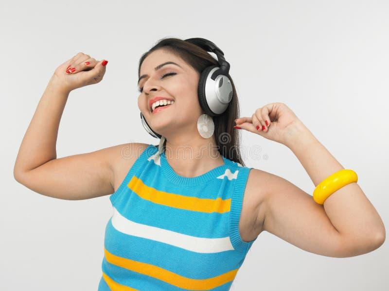 Download Asian woman enjoying music stock image. Image of face - 6794801