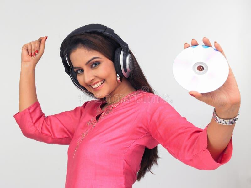 Download Asian woman enjoying music stock photo. Image of attitude - 6911240
