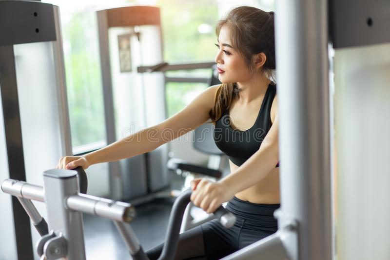 Asian woman Exercise workout at fitness gym royalty free stock image