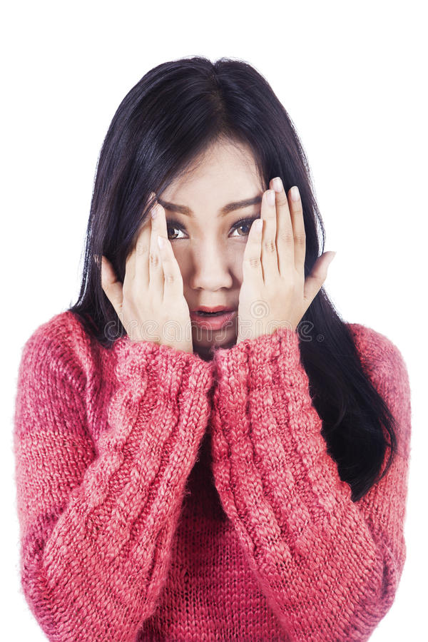 Asian woman express her fear isolated in white royalty free stock photography