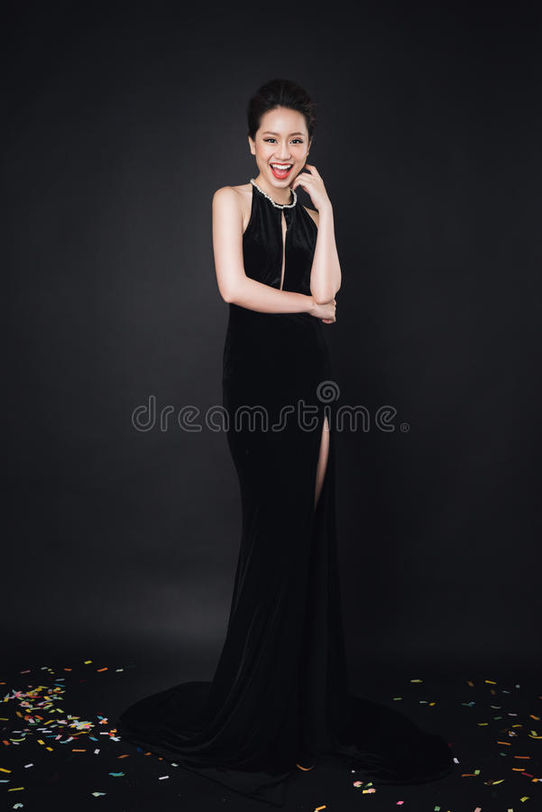 Download Asian Woman With Fashion Makeup In Luxury Black Dress Stock Photo