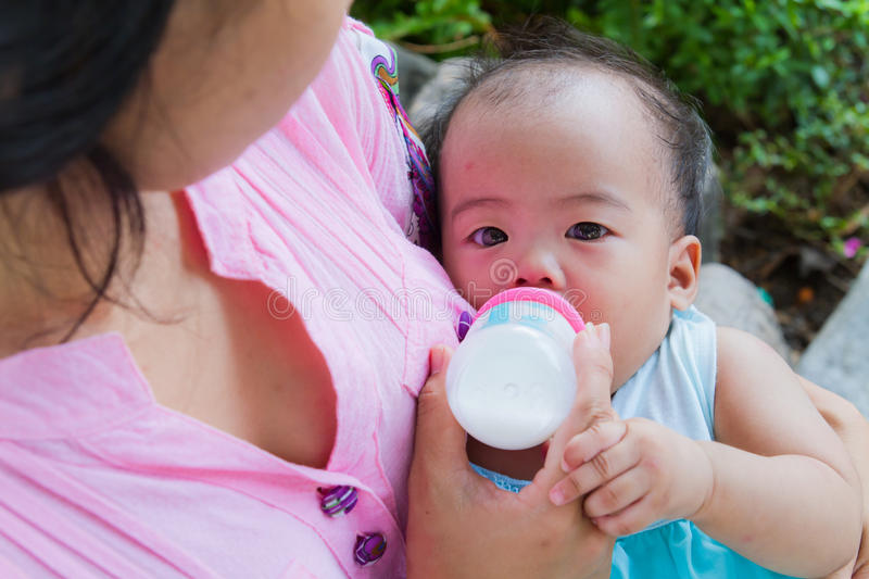 Asian woman feeding her baby from top stock images