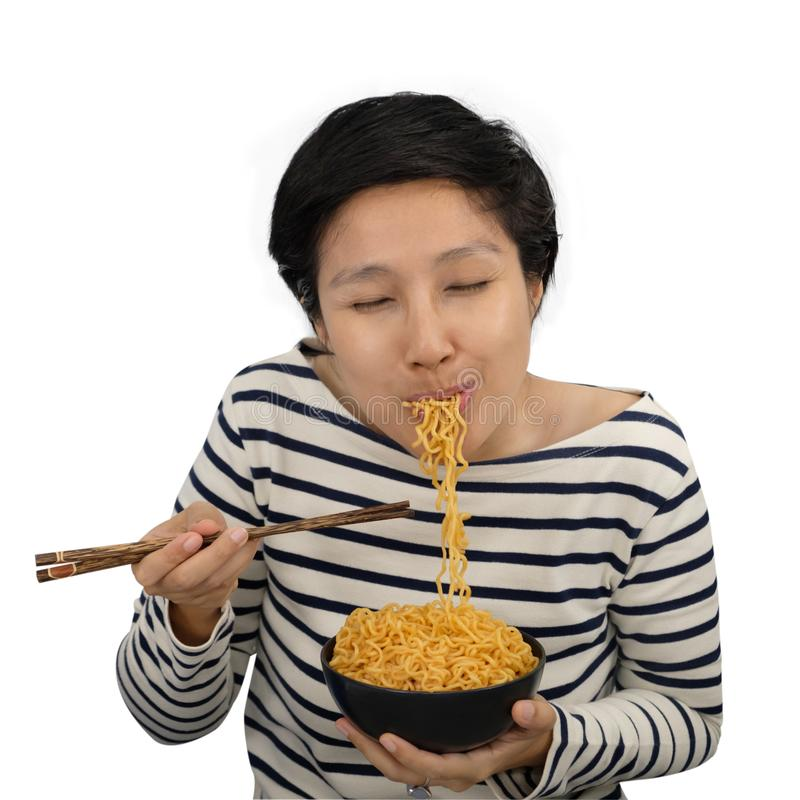 Asian woman Feel happy to eat instant noodles. royalty free stock images