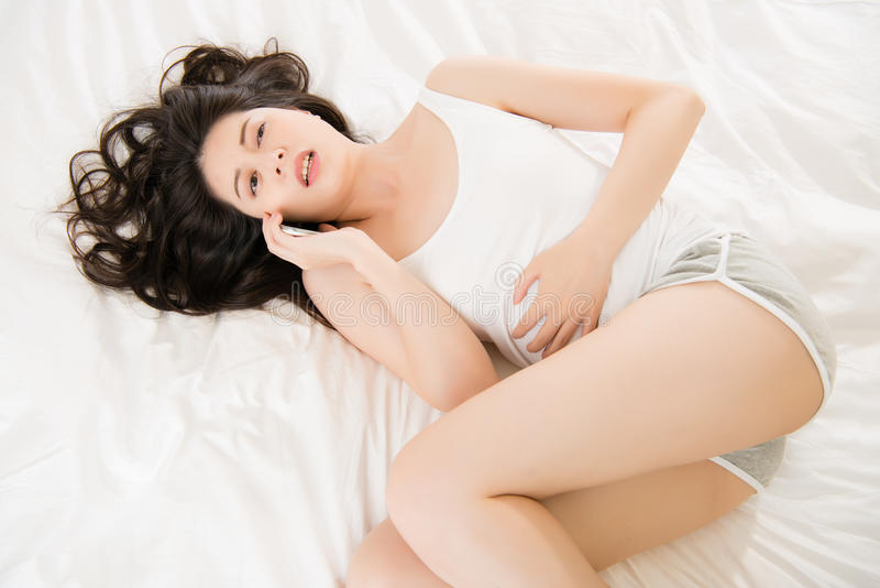 Asian woman feel sick use smart phone cry for help stock image