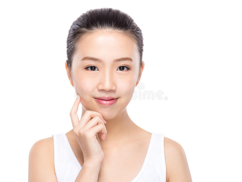 Asian woman with finger touch on face. Isolated on white background royalty free stock photos