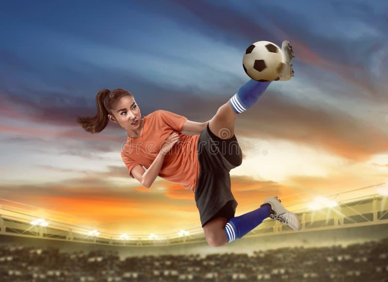 Asian woman football player kick ball stock photos