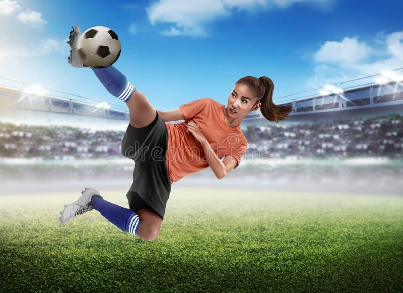 Asian woman football player kick ball royalty free stock photography