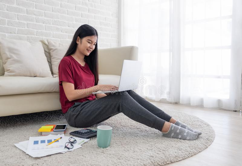 asian woman freelance working on laptop with paperwork at home,work at home concept.online learning concept. stock photos