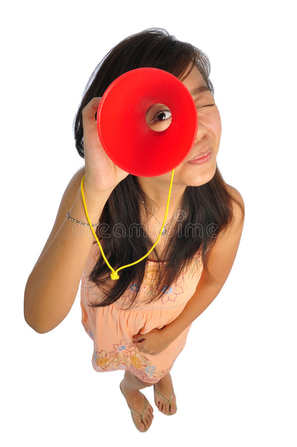 Asian Woman glancing through a red cone. Beautiful young Asian Woman picture taken from the top to give a big doll head effect stock image