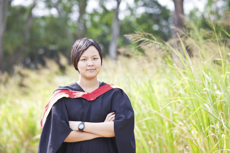 Asian woman graduation stock image