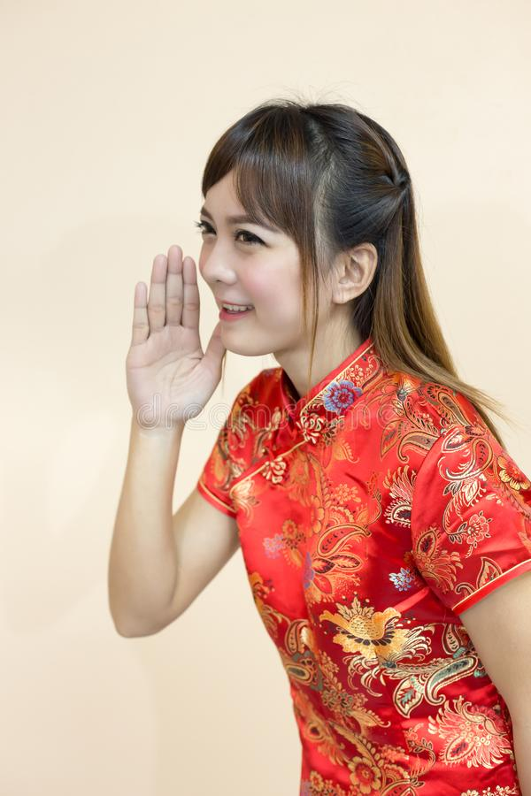 Asian woman greeting in traditional chinese or cheongsam with hand download asian woman greeting in traditional chinese or cheongsam with hand lift welcome expression and lucky m4hsunfo