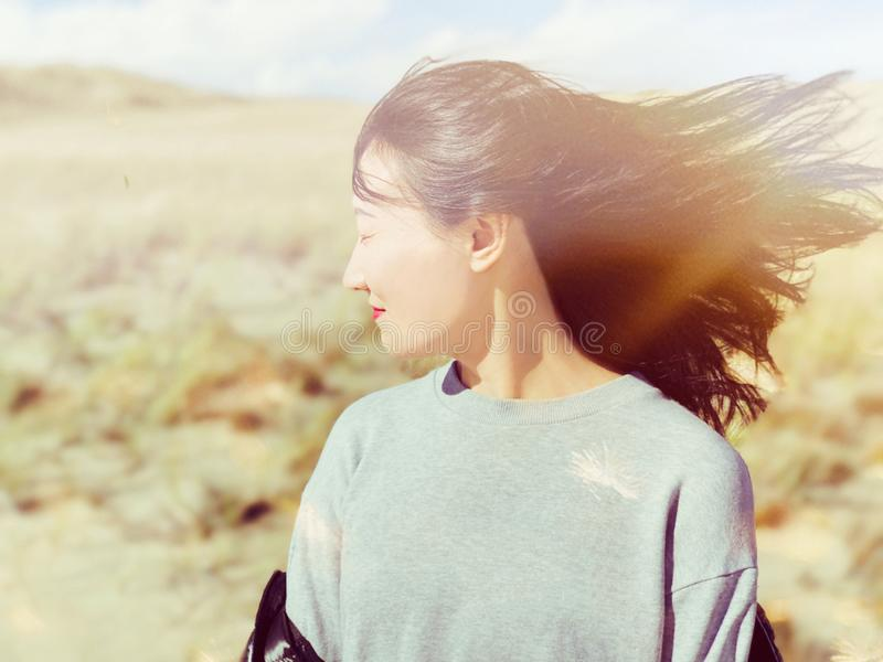 An asian woman hair flying in the air stock image