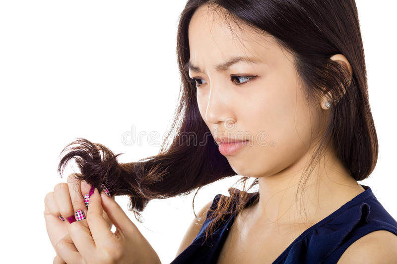 Asian woman with hair problem. On white stock photos