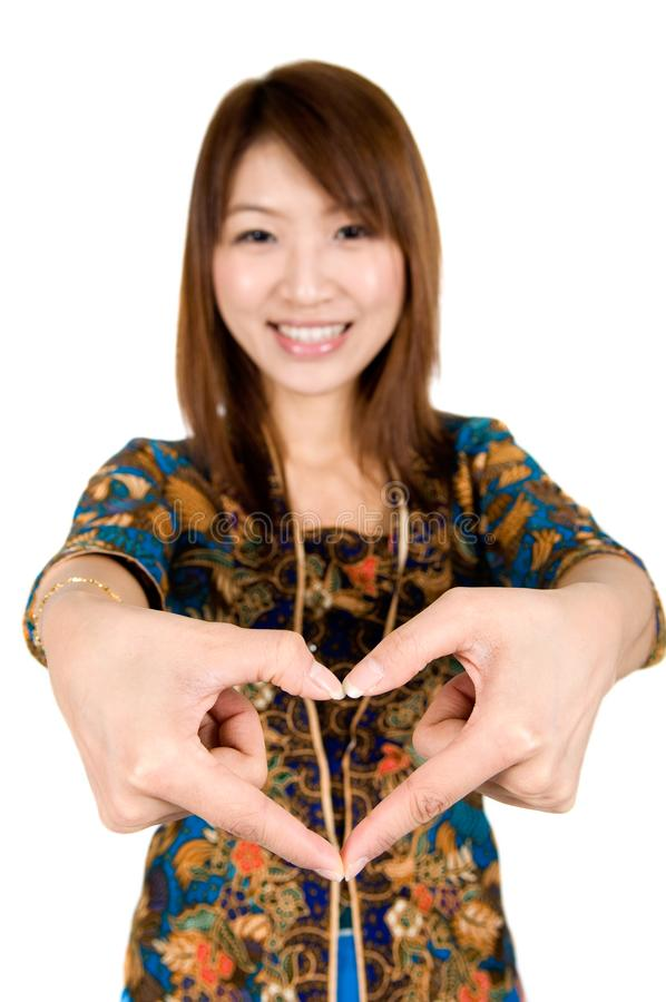 Asian woman hand forming a heart shape stock images