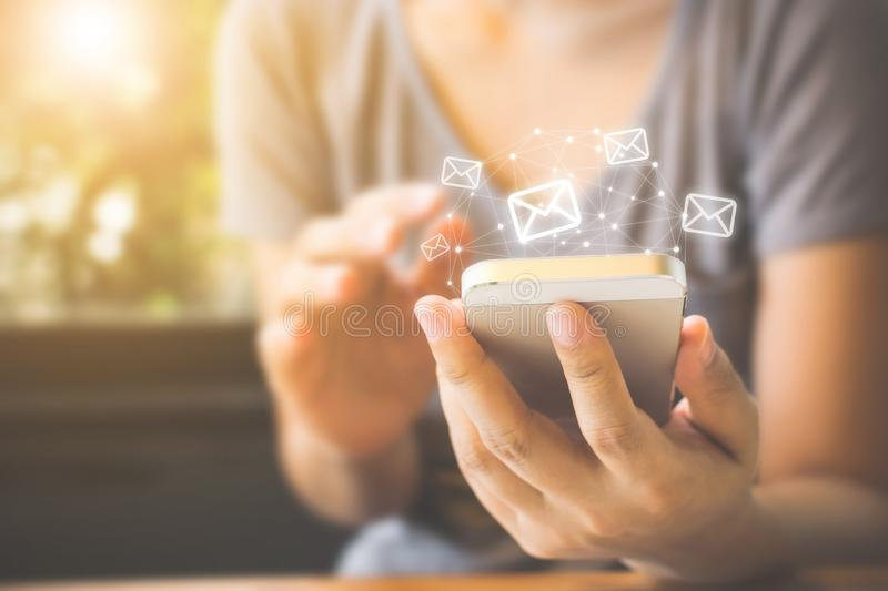 Asian woman hand using mobile phone with e-mail application, Con royalty free stock photo