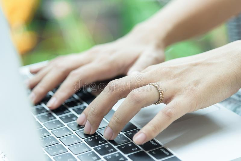 Asian woman hands and married ring has touching and typing on la stock photography