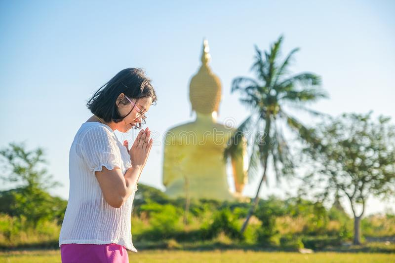 Asian woman hands to pay respect monks stock photography