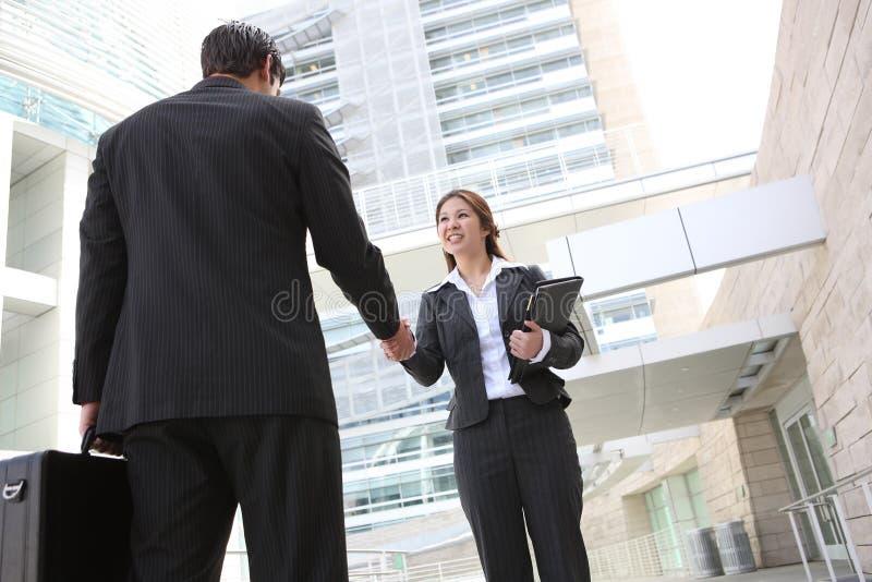 Asian Woman Handshake royalty free stock photos