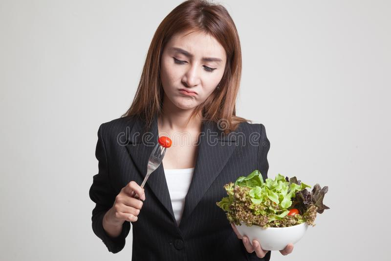 Asian woman hate salad. Asian woman hate salad on gray background royalty free stock images