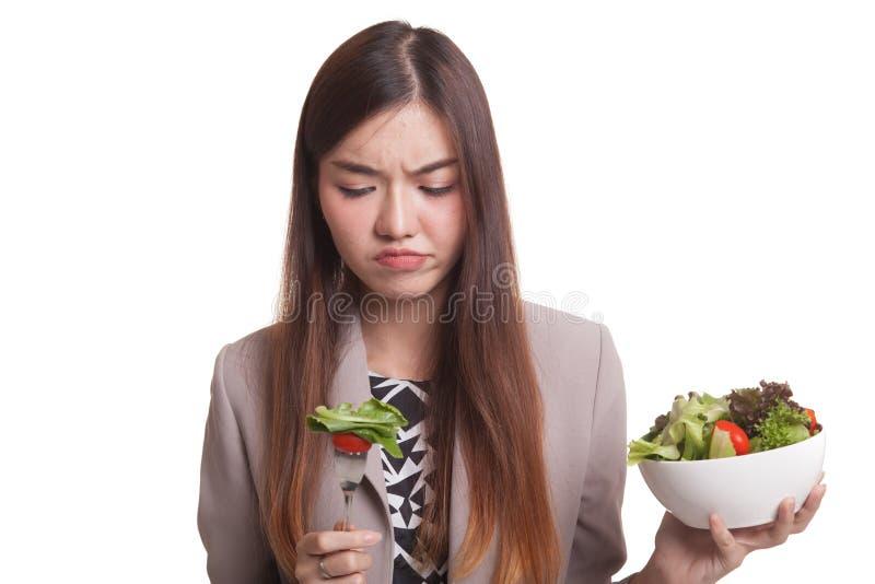Asian woman hate salad. Asian woman hate salad isolated on white background stock photography