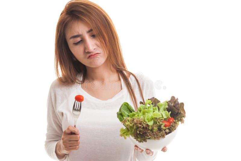 Asian woman hate salad. Asian woman hate salad isolated on white background royalty free stock image