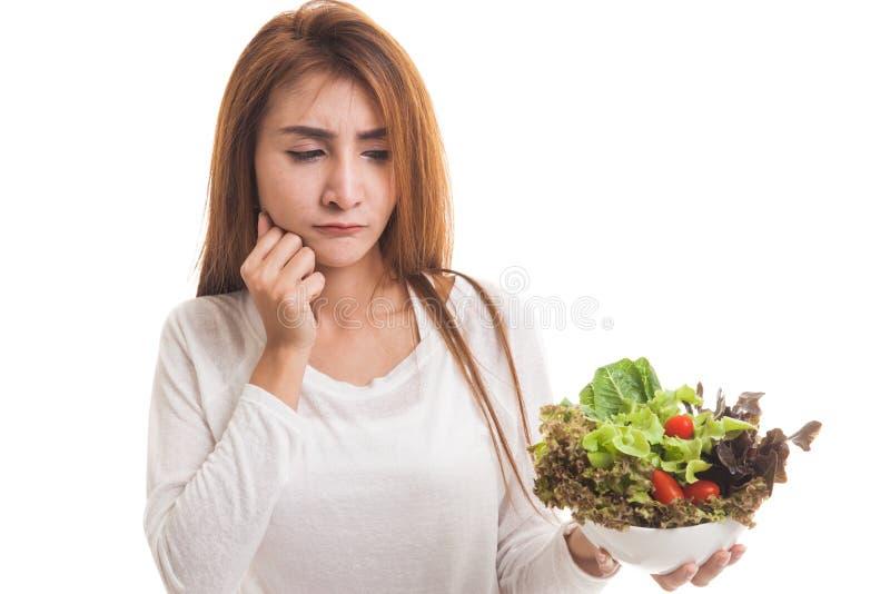 Asian woman hate salad. Asian woman hate salad isolated on white background royalty free stock photos