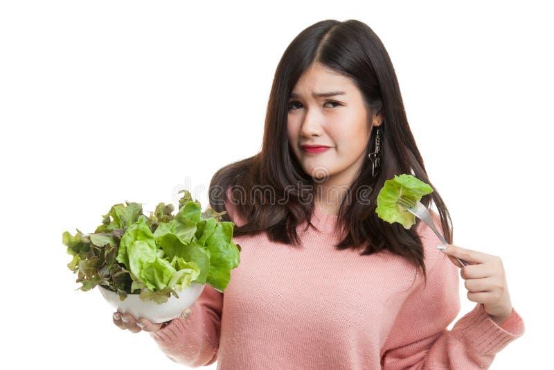 Asian woman hate salad. Asian woman hate salad isolated on white background stock photos