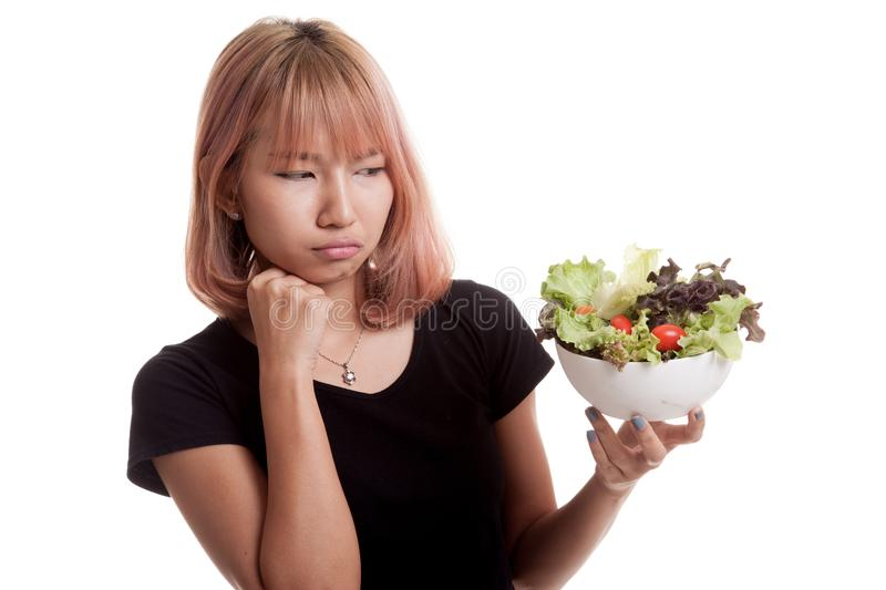 Asian woman hate salad. Asian woman hate salad isolated on white background royalty free stock images