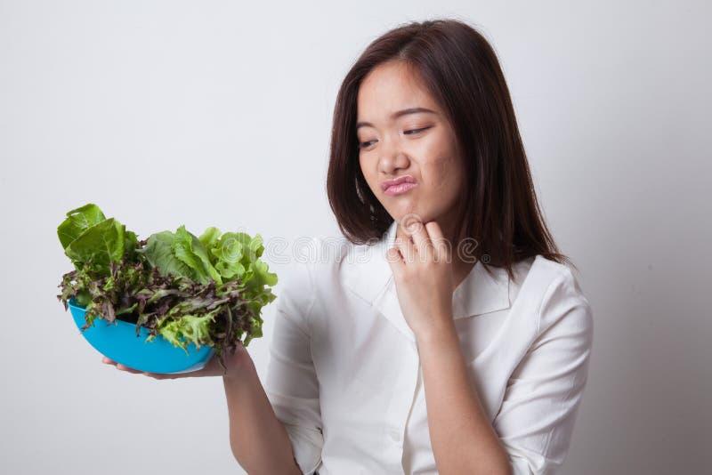 Asian woman hate salad. Asian woman hate salad on white background royalty free stock image