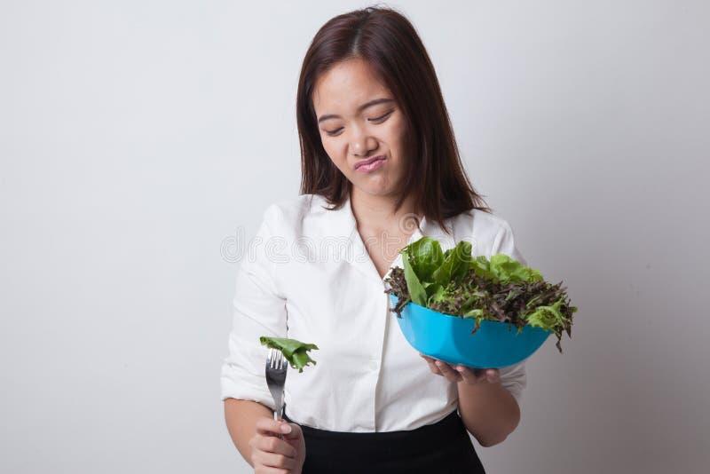 Asian woman hate salad. Asian woman hate salad on white background royalty free stock photos