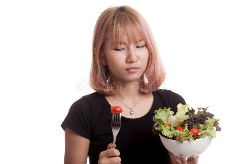 Asian woman hate salad. Asian woman hate salad on white background stock photos