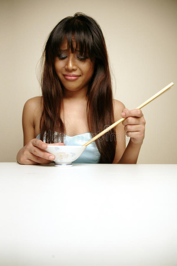 Download Asian Woman Hating Her Food Stock Image - Image: 12937461