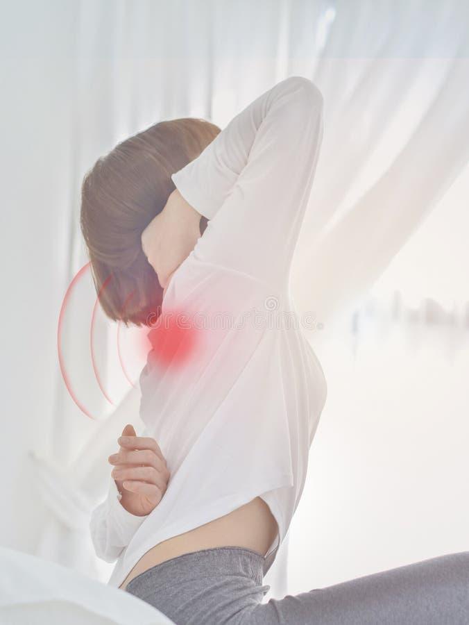 Sick woman with pain stock photos