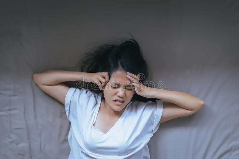 Asian Woman Have A Headache Feeling Serious On Bed After Wake Up In