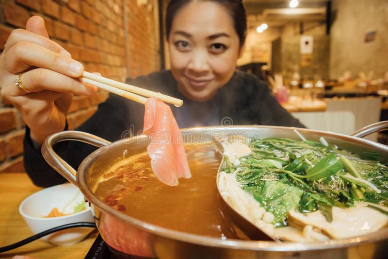Asian woman have shabu style dinner for winter season royalty free stock photos