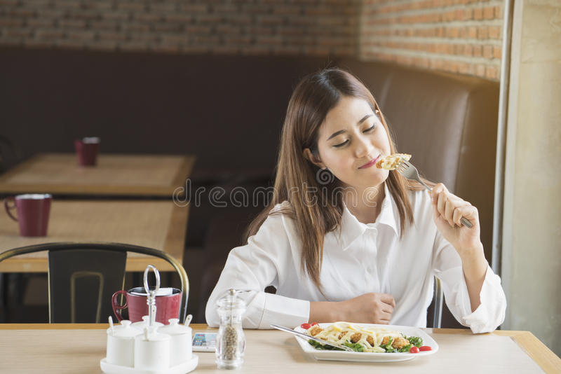 Asian woman having lunch stock photos
