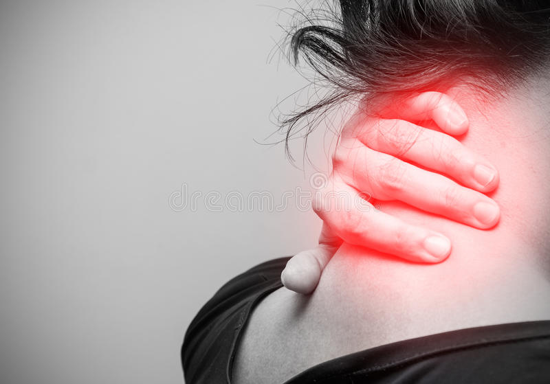 Asian woman having neck pain, black and white photo royalty free stock image